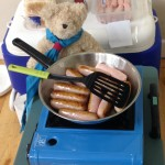 Tunstall Ted cooking sausages for lunch