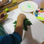 First paint your leaf then press on to paper